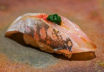 A photo of aji sushi