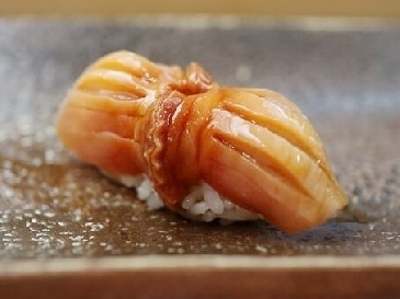 A photo of akagai sushi