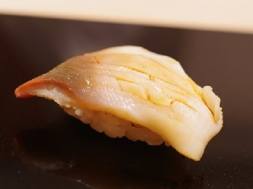 A photo of hokkigai sushi