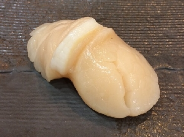 A photo of hotate sushi